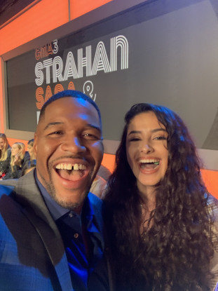 Ariana Contreras '22 snaps a photo with GMA host Michael Strahan!