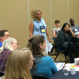 Dr. Aguanno (standing) leads a workshop at the Missouri conference.