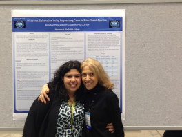 Kelly Ann Pena '13, recipient of the PROGENY Award, with her mentor, Dr. Jablon, at ASHA 2013. Kelly is currently attending the University of Wisconsin at Madison's Communication Sciences and Disorders program.
