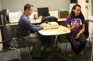 Student participates in audiology exam