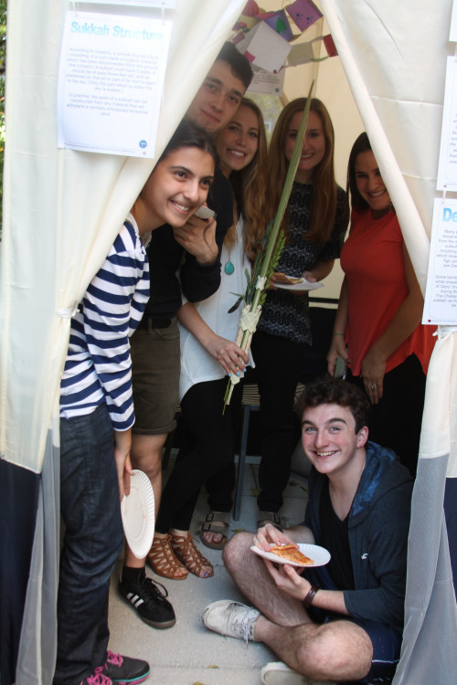 Hillel Students and Advisors in the Sukkah