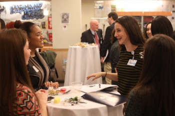 Students and mentors mingle at a career fair