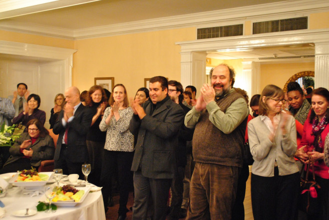 Faculty and staff alike applaud each other's efforts at the Office of Human Resource's annual Charter Day celebration