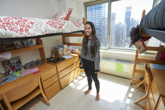 A resident in her new home at the 55th Street Residence Hall