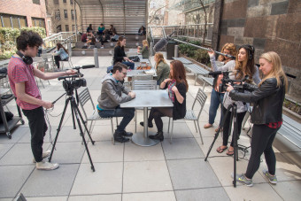 Students conduct a video shoot on the Lowerre Family Terrace