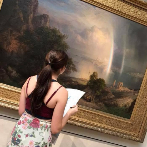 Student examines artwork at the Met