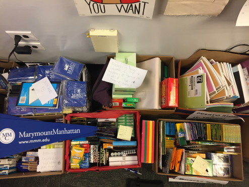 Boxes of supplies collected for Schools Helping Schools drive at MMC