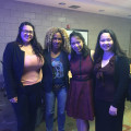 Professor Deirtra Hunter-Romagnoli and Patricia Miraflor (centered) along with two other students...