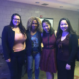 Professor Deirtra Hunter-Romagnoli and Patricia Miraflor (centered) along with two other students who attended the symposium.