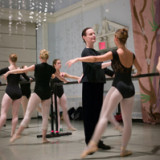 Chair of the Dance Department Katie Langan '92, B.A., instructing dancers in the Great Hall, said the NEA grant is a con...