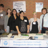 Marymount Manhattan students display information about MMC's Undergraduate Affiliate Network.