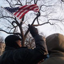 Holly Dougherty '09 snaps a photo of an on-looker waving an American flag during the Presidential Inauguration.