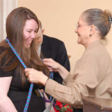 Twila Ligget, Ph.D., presents honors cords to a student during the Kappa Delta Pi Honor Society induction ceremony.