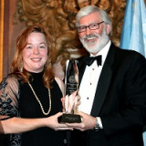 President Judson R. Shaver, Ph.D., presents Nora Moran '06 with the 75th Anniversary Gala award.