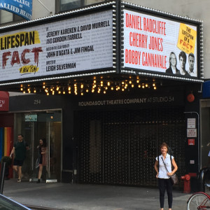 Adjunct Professor Deanna Twain under The Lifespan of a Fact marquee