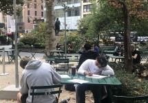 MMC students creating artwork in Madison Square Park for the course Art 111: Drawing I.