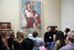 With students in front of Domenico Ghirlandaio's fresco of Saint Christopher and the Infant Christ at the Metrop...