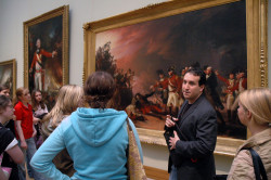 With students in front of John Trumbull's The Sortie Made by the Garrison at Gibraltar (1789) in the American Wing at the ...